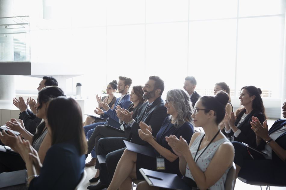 Business people clapping in conference audience