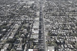 Aerial view of a city and numerous multi-unit homes