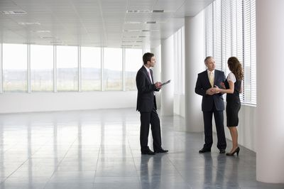 Business people inspect a commercial space