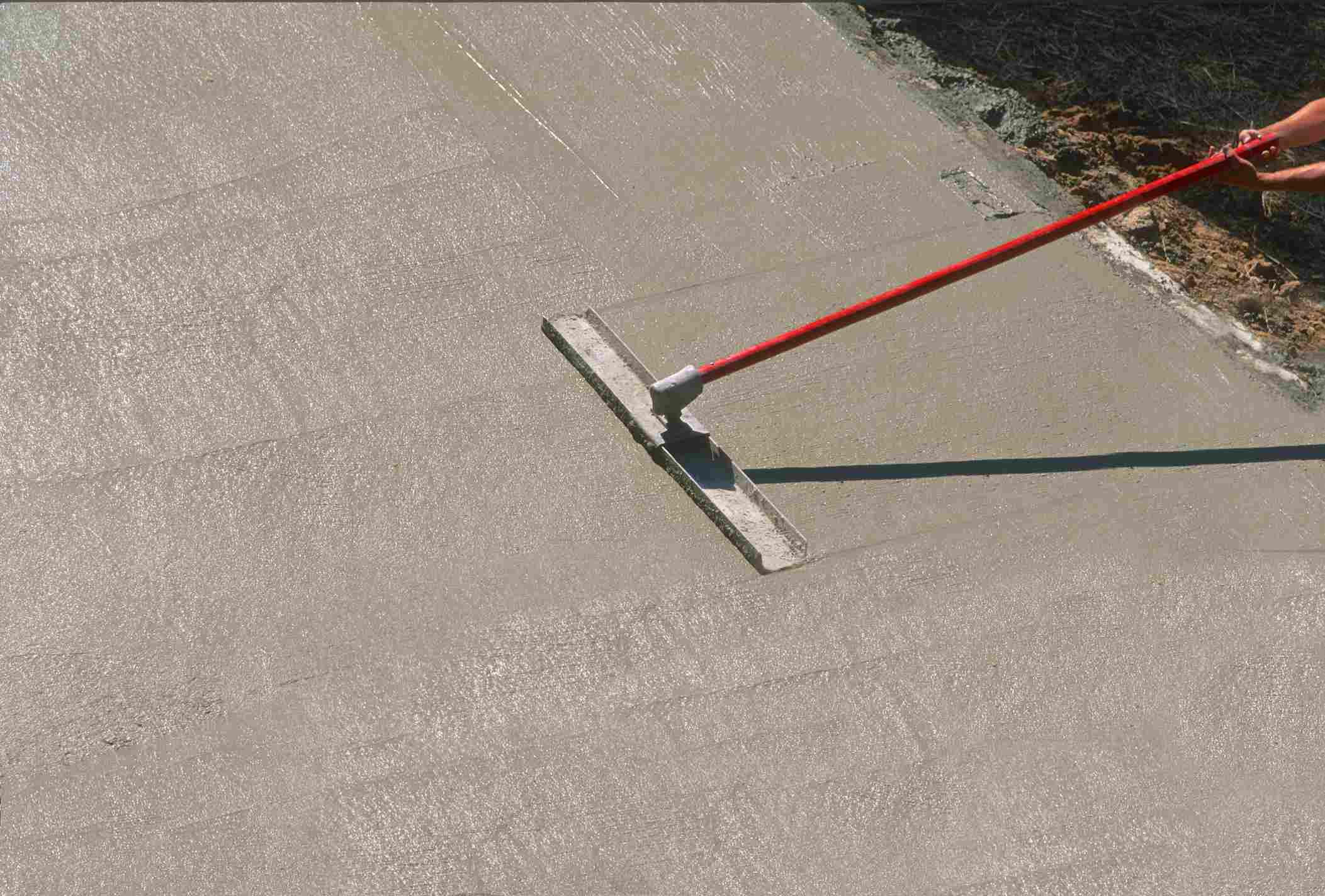 Finishing a concrete slab with a bull float