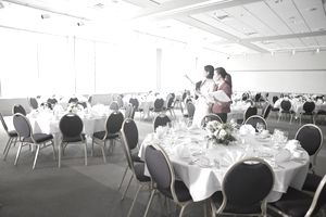 event planner discussing dining room before event