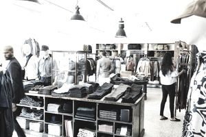 Shoppers looking at items in mens clothing boutique