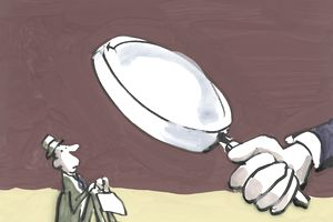 illustration of a businessman under a magnifying glass