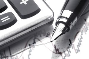 Calculating a stock's market-to-book financial ratio with a pen and calculator.