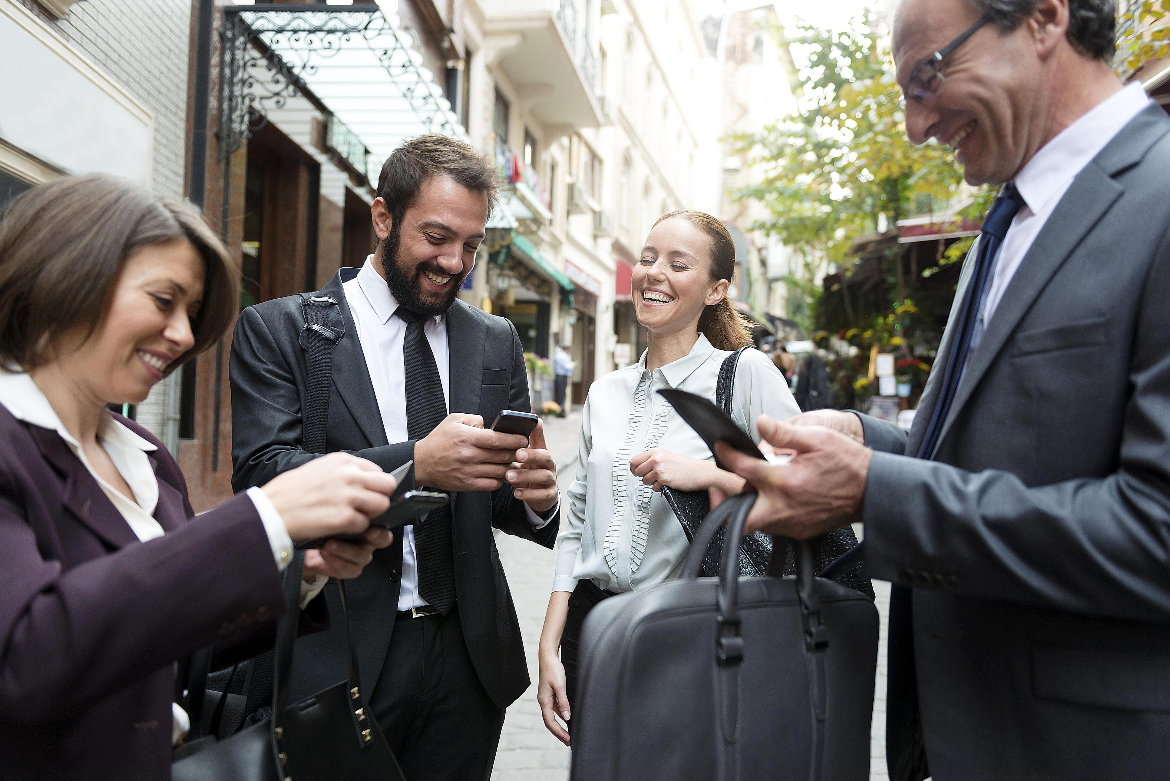 Businesspeople exchanging information