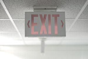 Exit sign showing a means of egress—a way to exit a property.