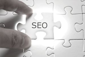 SEO word written on a puzzle piece