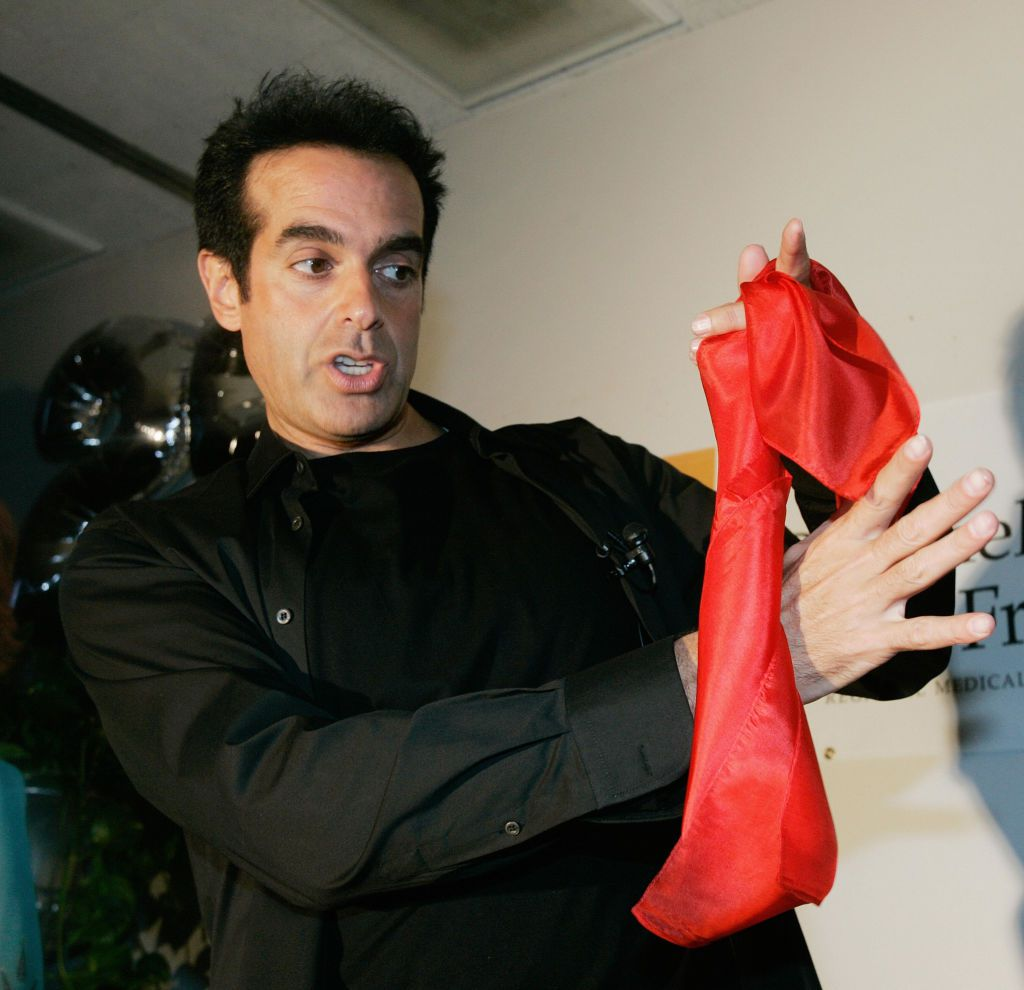 David Copperfield performs a magic trick