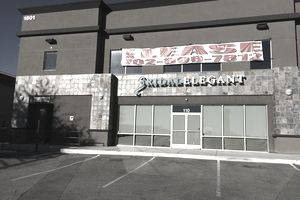 "Exterior view of a commercial building with a ""for lease"" banner."