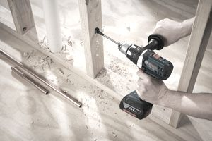 Drilling a hole in wood framing with the Bosch DDH181X-01