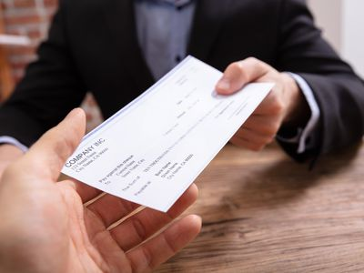 Employee receiving their paycheck