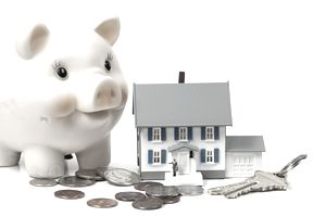 Piggy bank next to a house