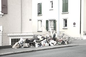Stuff piled up on the curb outside an apartment building after the eviction of a tenant.