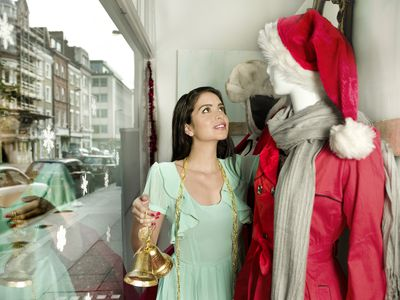 shop owner desiging the mannequin in her store