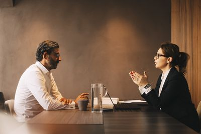 Lawyer meeting with client in office