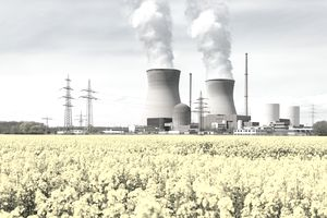 Nuclear power plant with yellow field and big blue clouds in Germany.