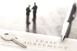 sepai image of a lease agreement and two men shaking hands