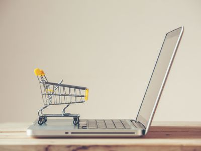 Small shopping cart on a laptop