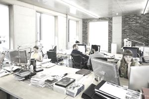 Business employees working in an open office
