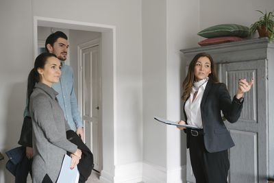 real estate agent showing home to broker-provided lead