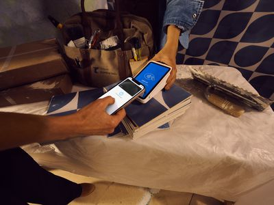 Seller using Square on phone