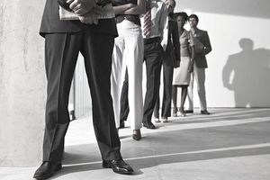 Business executives standing in office, low angle view