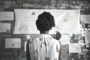 Businesswoman reviewing a flow chart of delegated projects