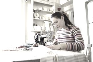 woman sewing at kitchen table