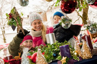 Mom with kids shopping for holiday decor at a retail store