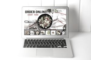 Computer with Online food delivery app on screen. lifestyle conc