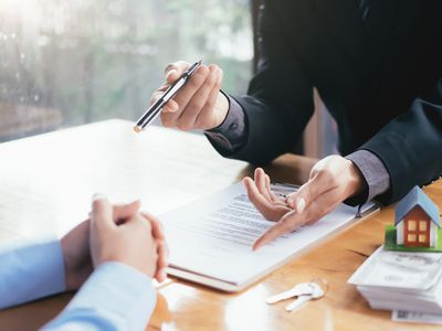 Businessman Giving Document To Client