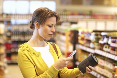 woman looking at product in the store