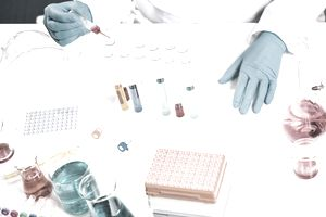 scientists conducting research in a laboratory. drug discovery, pharmacology and biotechnology concept. science and medical research background