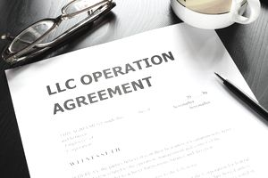 A limited liability company operation agreement with pen
