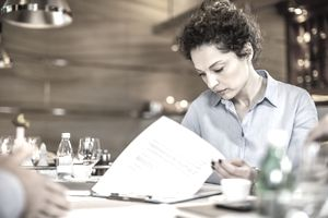 Female business owner looking at paperwork
