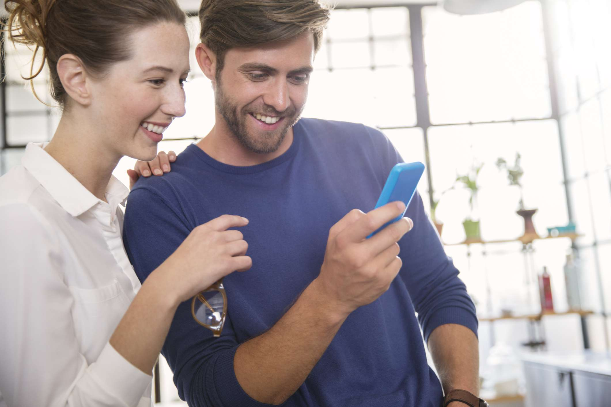 Two people looking at a phone