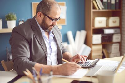 Mature Adult man filing extension for business taxes