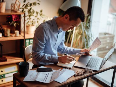Man compiles information for his personal financial statement