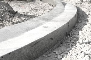 Concrete curb formed using bond breaker construction methods.