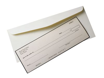 Paycheck that has not been claimed being prepared to mail back.