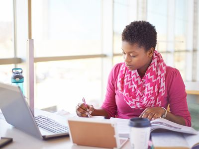 Woman doing research in front of laptop