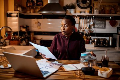 A woman looks at her investments and how much she will pay in taxes if she sells them.