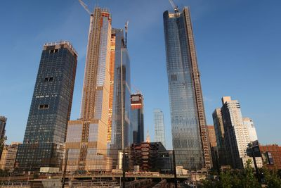 High rise buildings with structural support beams.