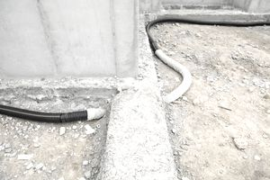 Gravel being used in a French drain system
