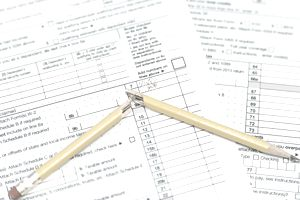Tax forms with broken pencil
