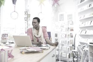 female business owner at laptop