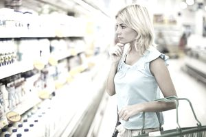 Woman shopping for dairy in a food store