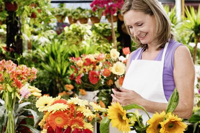 Female florist holding pruning shears