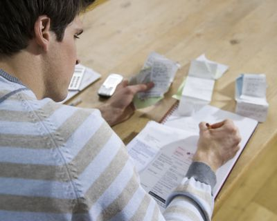 Man accounting for receipts in a journal