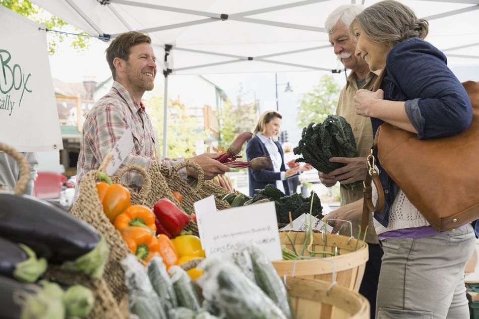 Older couple shopping at farmers market